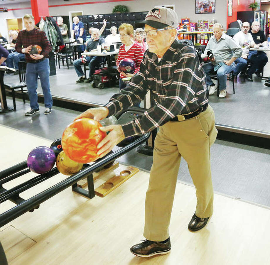 Herman Lebegue, 91, of Alton, gets ready to send his ball down the lane at Bowl Haven in Alton. Lebegue is the oldest member of the Senior Bowling League.