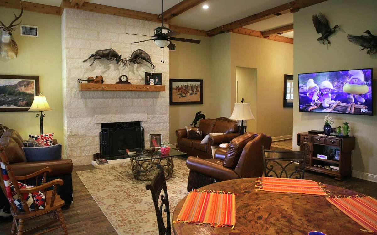 The family room has a large, limestone-faced fireplace.