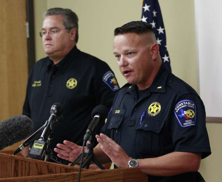 Lt. Tim Cade with the Montgomery County Precinct 1 Constable's Office speaks beside Precinct 1 Constable Philip Cash during a press conference following a fatal boat crash on Lake Conroe, Wednesday, July 12, 2017, in Willis. A 39-year-old father was killed July 11 around 9:30 p.m. after a fisherman heading ashore crashed into a family of three on the lake. The man's wife and young daughter were also injured in the crash. Two people on the fisherman's boat were rescued from the water but did not appear to have any serious injuries. Photo: Jason Fochtman, Staff Photographer / Houston Chronicle / Conroe Courier / HCN