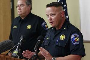 Lt. Tim Cade with the Montgomery County Precinct 1 Constable's Office speaks beside Precinct 1 Constable Philip Cash during a press conference following a fatal boat crash on Lake Conroe, Wednesday, July 12, 2017, in Willis. A 39-year-old father was killed July 11 around 9:30 p.m. after a fisherman heading ashore crashed into a family of three on the lake. The man's wife and young daughter were also injured in the crash. Two people on the fisherman's boat were rescued from the water but did not appear to have any serious injuries.