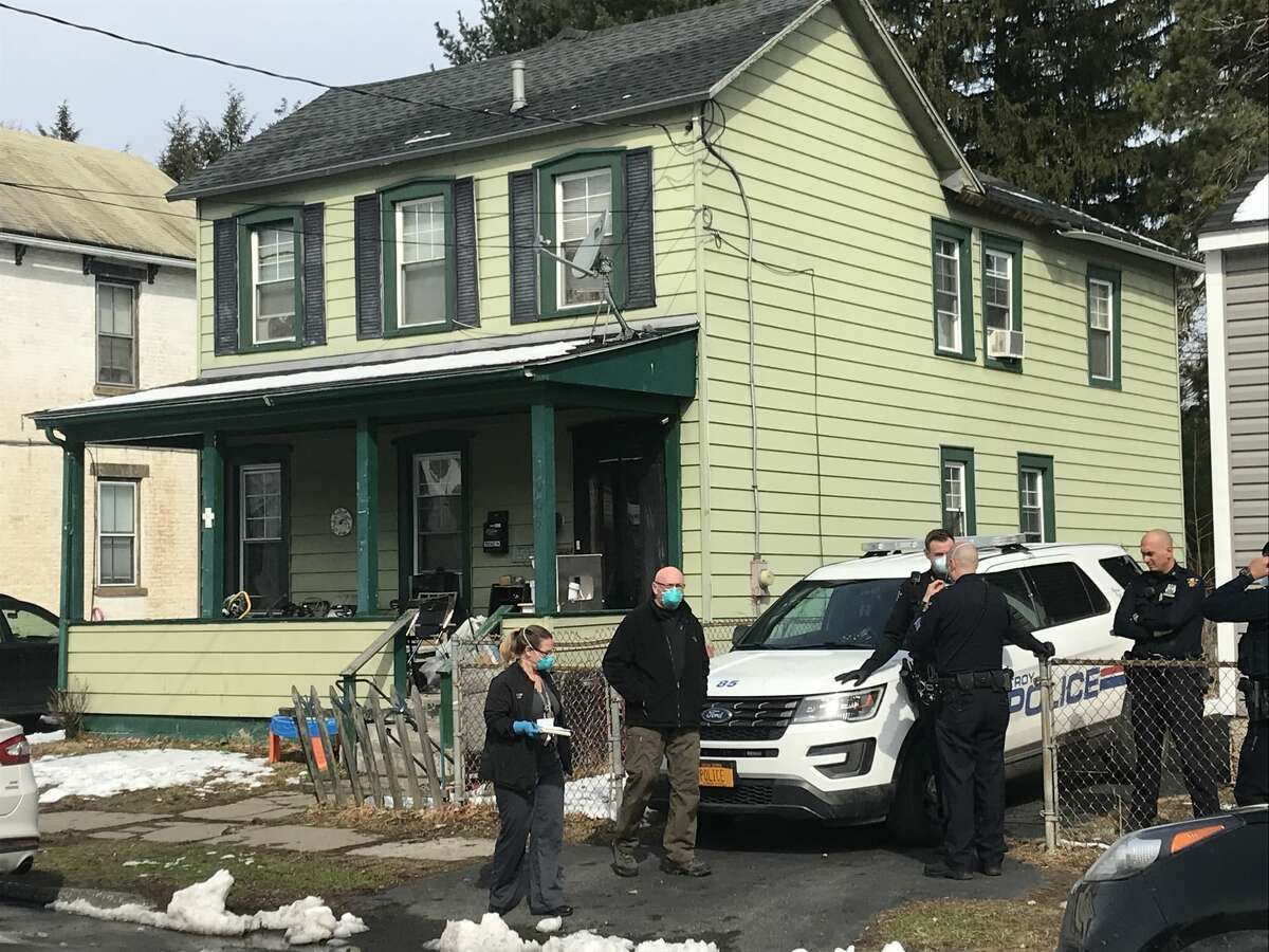 Police officers and detectives investigate the deaths of two people found dead from an apparent overdose inside 1905 Highland Ave., Troy,