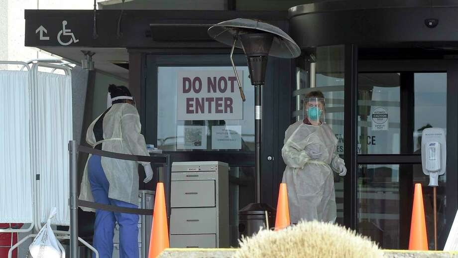 Nurses set up to test for the COVID-19 virus in an area outside Stamford Hospital on March 17. Photo: Matthew Brown / Hearst Connecticut Media / Stamford Advocate