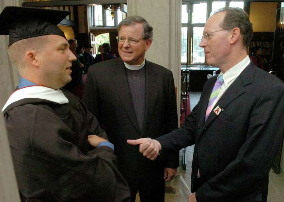 Douglas Perlitz, Fairfield University President Father Jeffrey von Arx, and Dr. Paul Farmer at the school's Fall convocation on September 8, 2006. On Wednesday August 18, 2010, Douglas Perlitz pleaded guilty to one charge involving the sexual abuse of a minor boy. Perlitz will be sentenced on Dec. 21. Photo: File Photo / Connecticut Post File Photo