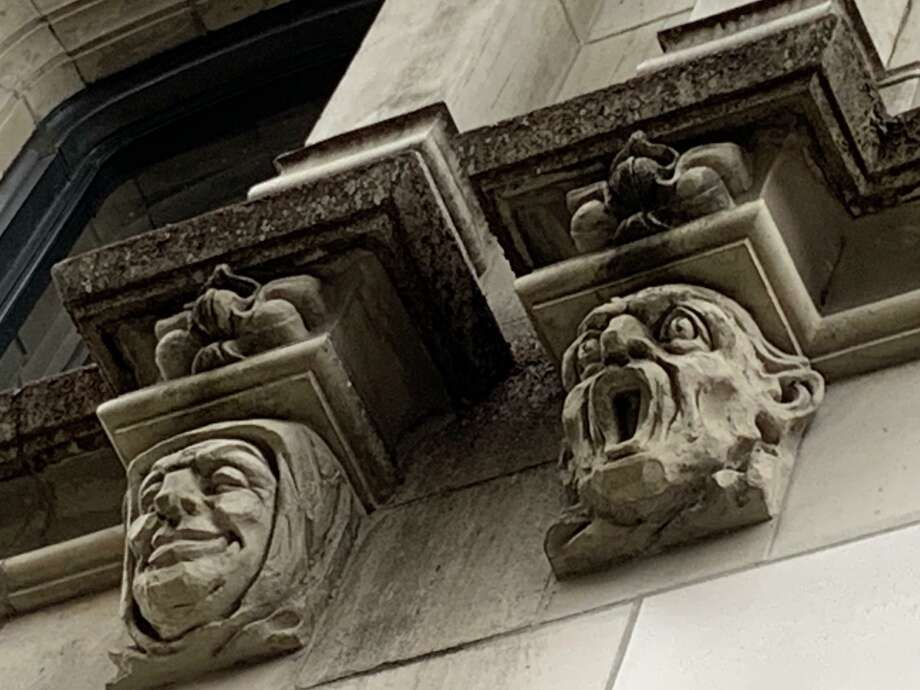 Rows of grotesque faces circle the lower exterior of the Tower Life Building, which opened in 1929 as the Smith-Young Tower. Photo: René Guzman