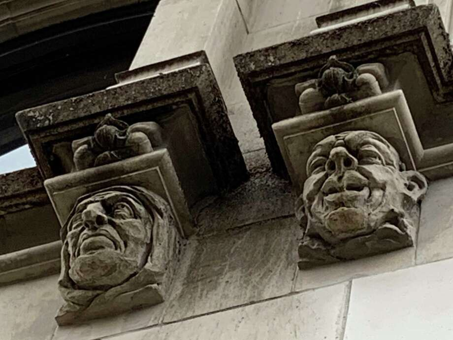 Rows of grotesque faces circle the lower exterior of the Tower Life Building in downtown San Antonio. Photo: René Guzman