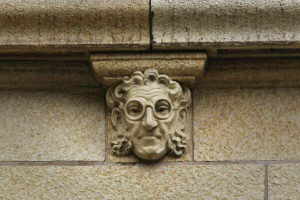 Architectural history instructor Jane Martin believes this face with glasses represents a doctor. But she's unsure about the other four faces on the former Nix Medical Center building.