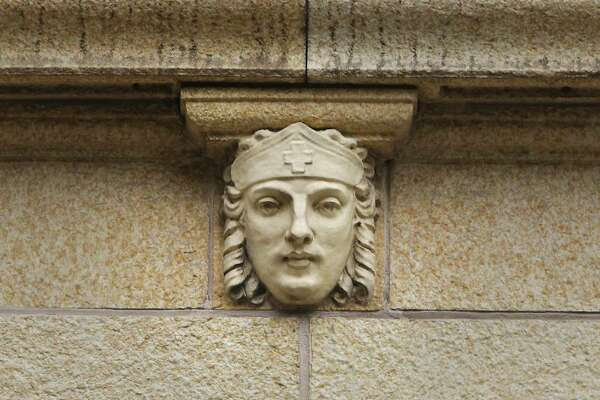 A closer look at one of the five gargoylelike faces on the former Nix Medical Center building.