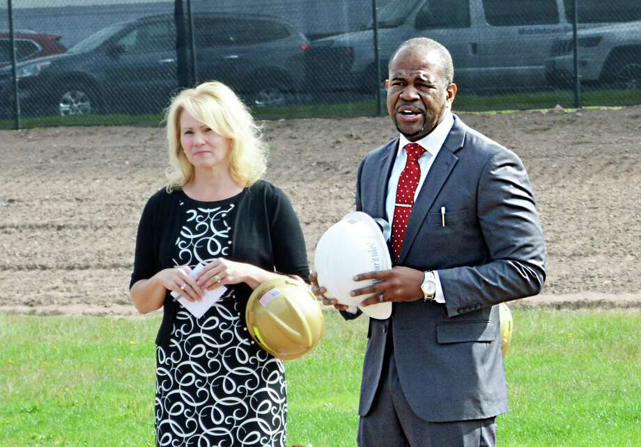 Middletown School superintendent Michael Conner, right, stands with former common councilwoman Mary Bartolotta, right, during a ceremonial groundbreaking for the new Woodrow Wilson Middle School in September 2019. Photo: Hearst Connecticut Media File Photo