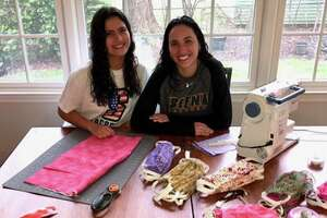 Siena lacrosse player Megan Power, left, and her sister, Grace, are making masks in their kitchen in Cranford, N.J. (Megan Power)