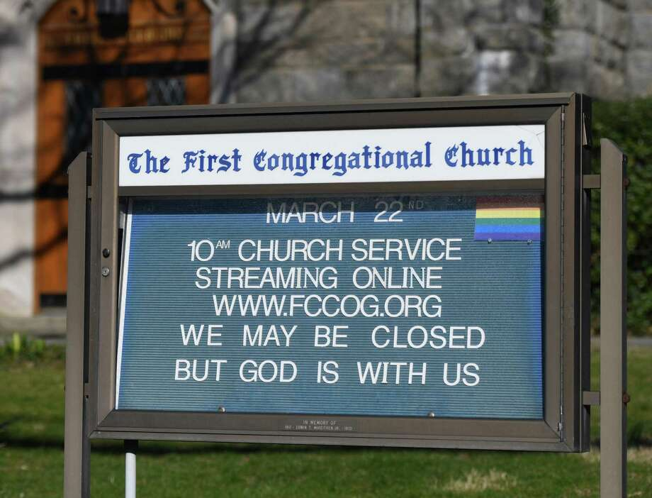 A sign is displayed telling of church services streamed online outside First Congregational Church of Greenwich in Old Greenwich, Conn. Tuesday, March 24, 2020. Although churches are closed to the public because of the coronavirus, many of them are holding streaming services live online. Photo: Tyler Sizemore / Hearst Connecticut Media / Greenwich Time