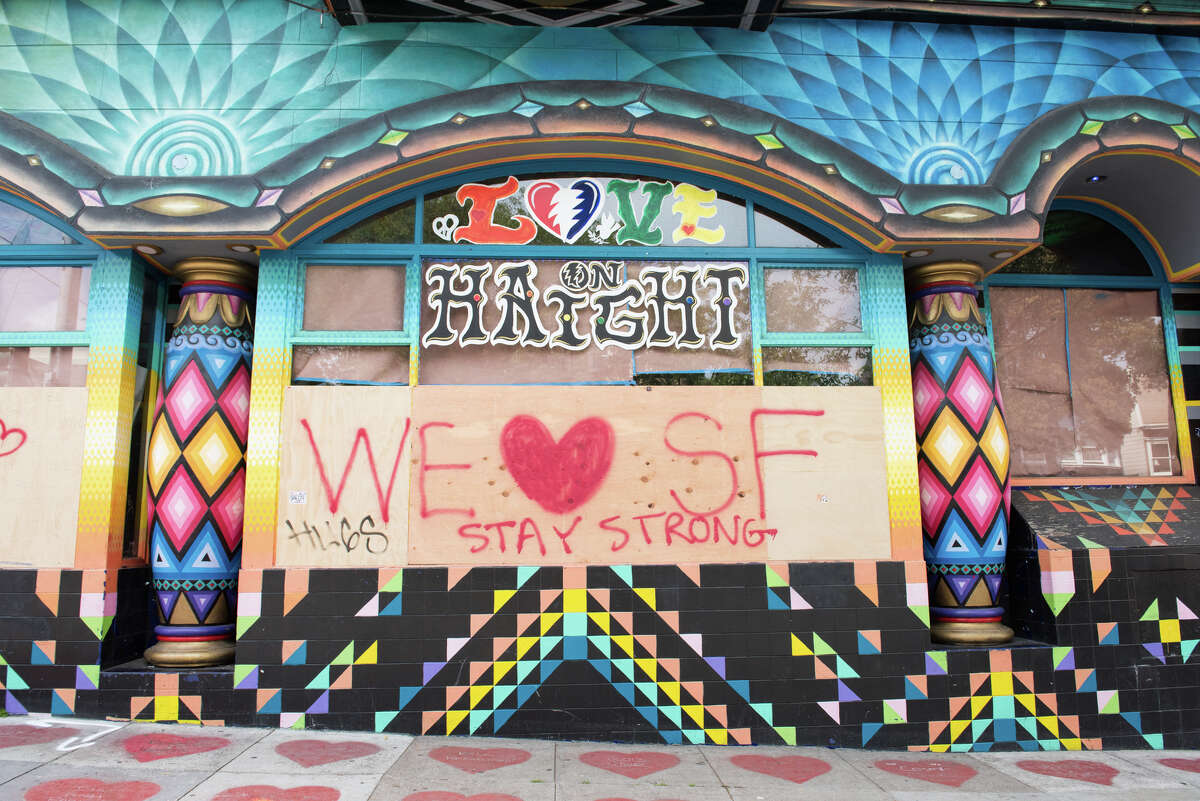 A message posted on boarded-up Love on Haight shop in San Francisco on Tuesday, March 24, 2020.