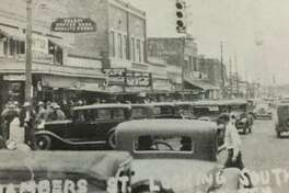 Conroe's first traffic light after the oil boom at the intersection of what is today Main Street and Texas 105 looking south down Main Street.