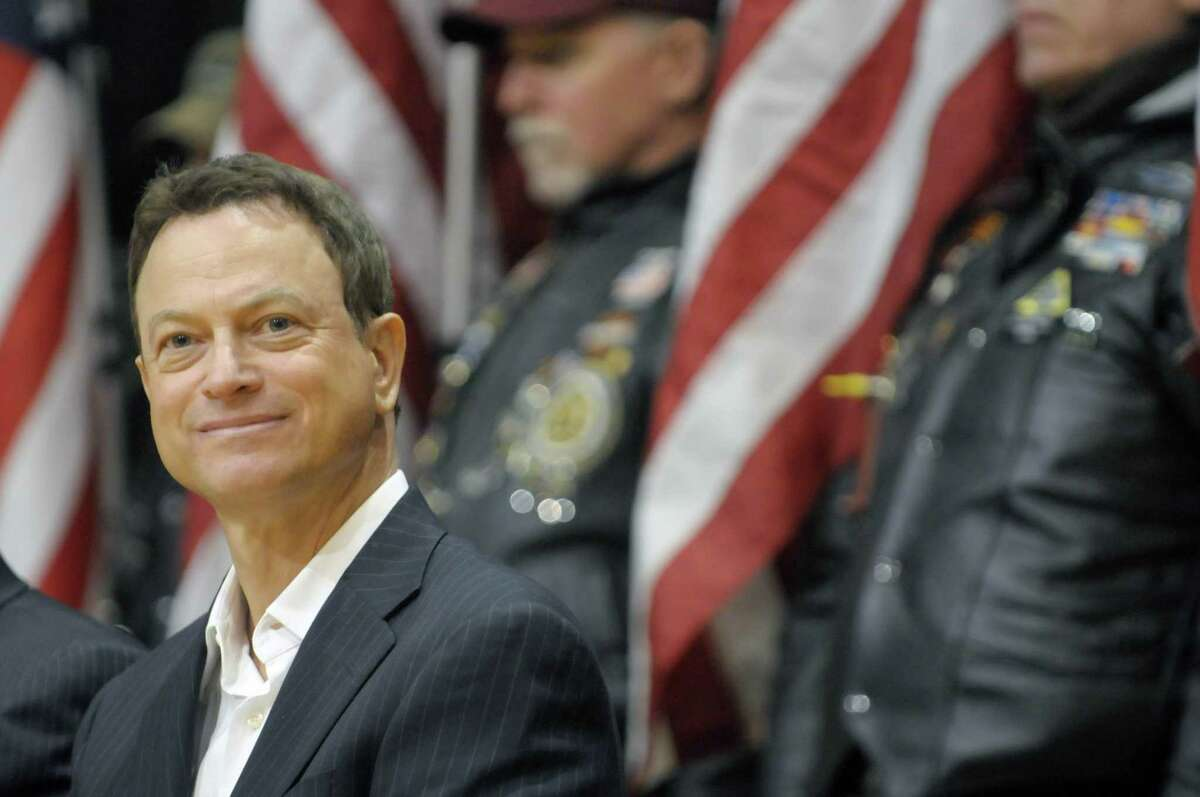 Actor Gary Sinise takes part in an event at the Washington Avenue Armory on Monday, March 12, 2012 in Albany, NY. The event at the armory was held to announce a benefit concert in April will a band that Sinise plays in will perform to help raise funds to help build a home for disabled veteran Joseph Wilkinson and his family. The Stephen Siller tunnel to Towers Foundation and the Gary Sinise Foundation are the two groups involved in the building of homes for disabled veterans. Wilkinson served as a technical sergeant in Air Force Security Forces during the invasion of Iraq in 2003. (Paul Buckowski / Times Union)