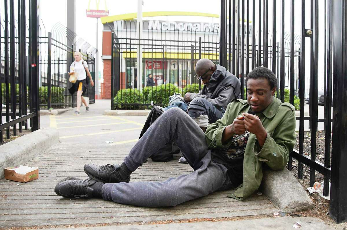 Local men who are homeless hang out on Main Street in downtown Houston in March, just as the pandemic hit the city.