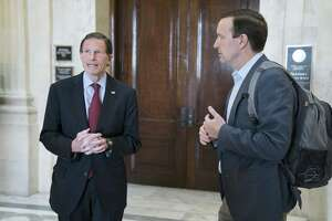 Senators Richard Blumenthal, left, and Chris Murphy, Democrats from Connecticut, depart from a Democratic caucus meeting in the Russell Senate Office Building in Washington, D.C., U.S., on Sunday, March 22.
