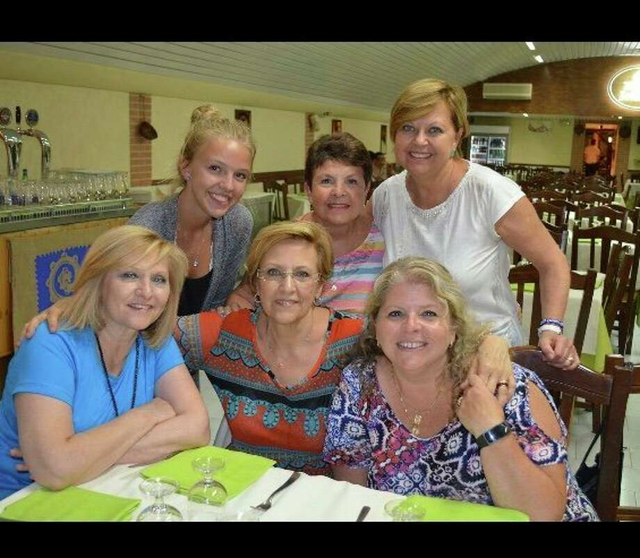 Maria Pia Cohoon, back row, center, poses with family members in Italy. Cohoon keeps in daily contact with her cousins and aunts, receiving updates about coronavirus. (Photo provided)
