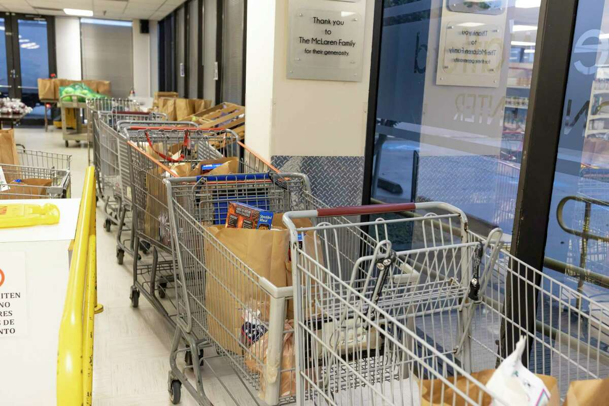 Shopping carts line up at the Northwest Assistance Ministries Watford Nutrition Center in Tomball, Friday, March 20, 2020. The food pantries biggest donors are Krogers and Walmart which have been assisting them with keeping the pantry in stock during the new coronavirus pandemic.