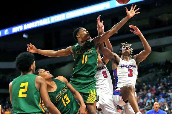Klein Forest's Daylan Hamilton #11 battles for a rebound with Duncanville's Jahmi'us Ramsey #3.. IL boys basketball 6A State Final between Klein Forest and Duncanville on Saturday March 9, 2019 at the Alamodome in San Antonio, Texas. (Ron Cortes/ Special Contributor)