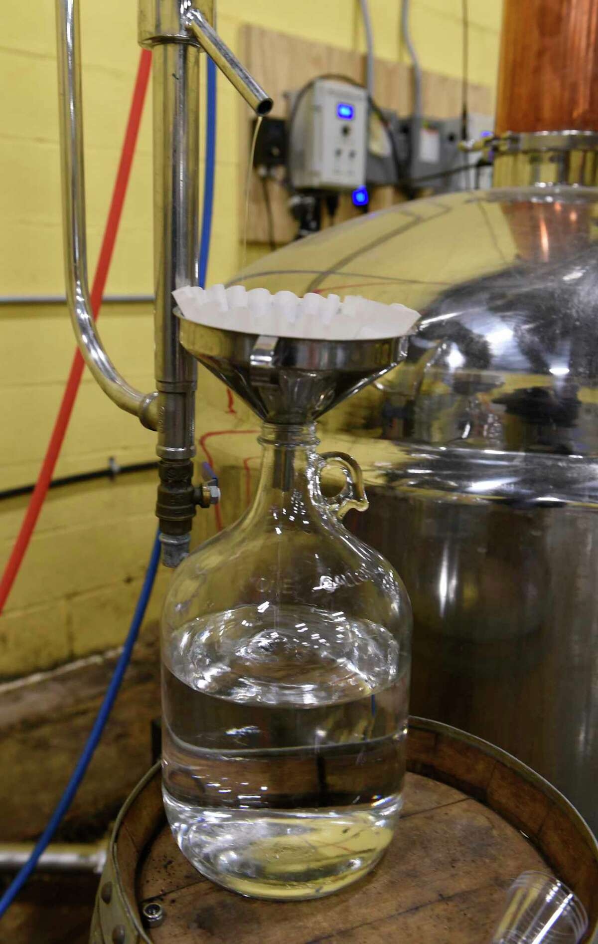 Vodka is produced in a still at Capital Distillery on Wednesday March 25, 2020 in Albany, N.Y. The distillery's owner Douglas Estadt has been making hand sanitizer with the