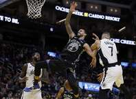 Los Angeles Clippers' Amir Coffey (7) fouls Golden State Warriors' Mychal Mulder (15) in the second half of an NBA basketball game Tuesday, March 10, 2020, in San Francisco. (AP Photo/Ben Margot)