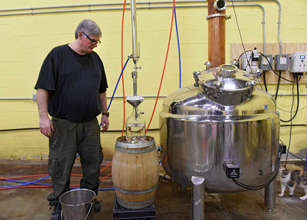 Douglas Estadt, owner of Capital Distillery, stands next to his still where he makes vodka on Wednesday March 25, 2020 in Albany, N.Y. Doug has been making hand sanitizer with the