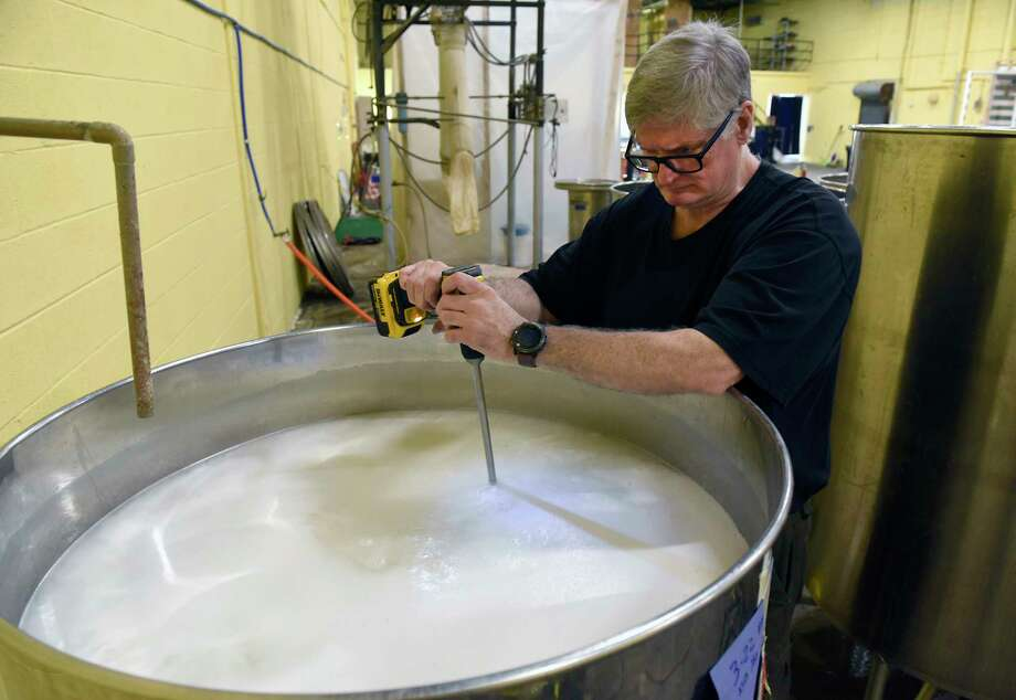 "Douglas Estadt, owner of Capital Distillery, mixes the mash he makes vodka on Wednesday March 25, 2020 in Albany, N.Y. Doug has been making hand sanitizer with the ""tails"" left over when he distills vodka, adding tea tree oil and lavender as well as aloe vera gel. (Lori Van Buren/Times Union) Photo: Lori Van Buren, Albany Times Union / 40049091A"