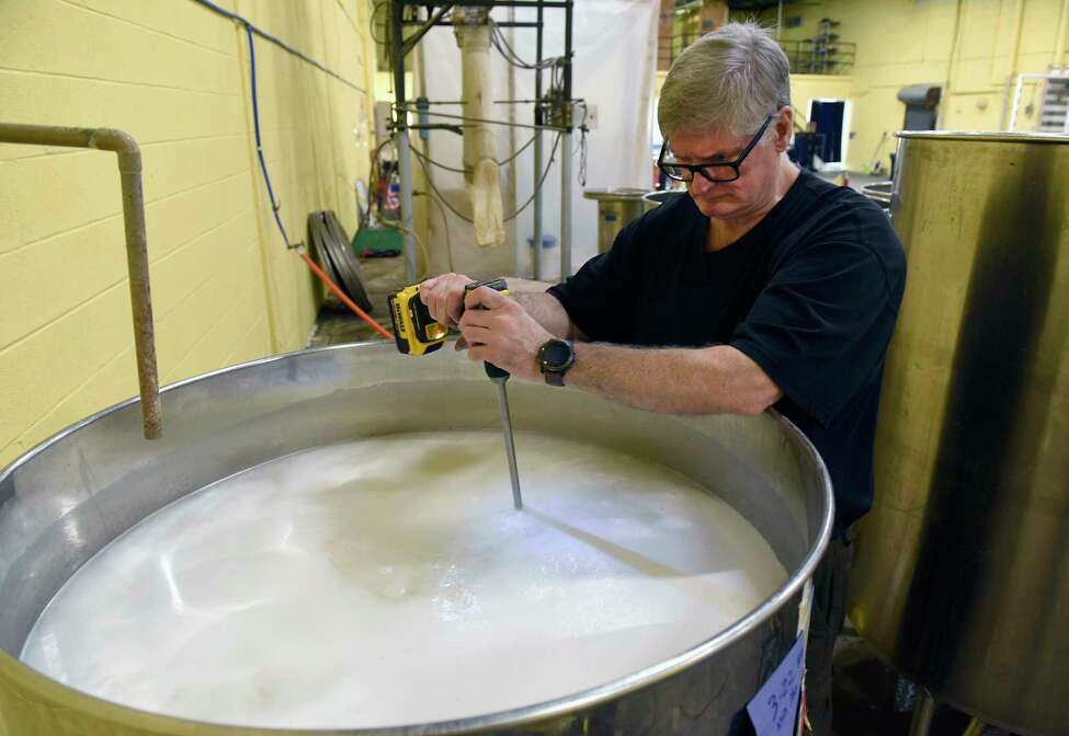 Douglas Estadt, owner of Capital Distillery, mixes the mash he makes vodka on Wednesday March 25, 2020 in Albany, N.Y. Doug has been making hand sanitizer with the
