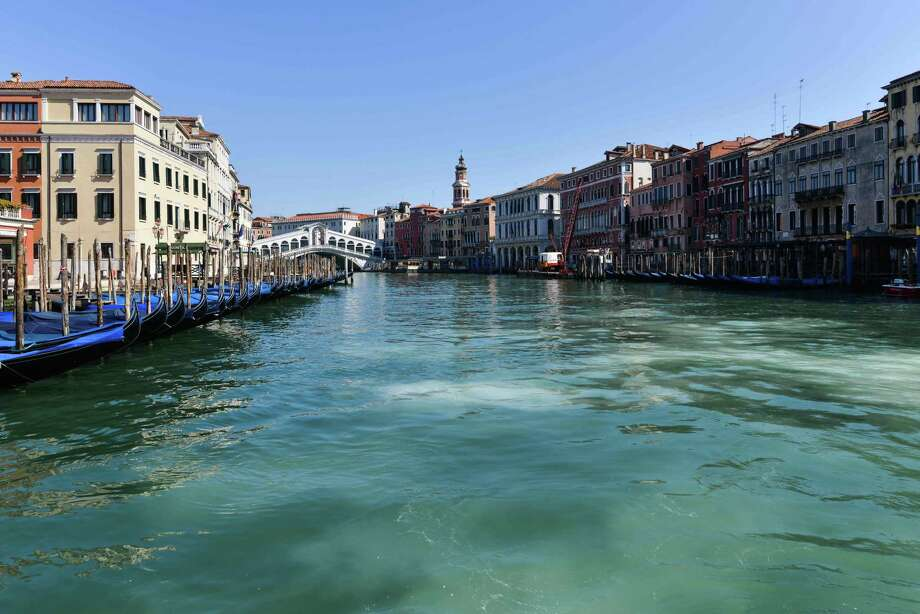 A general view shows clear waters of the Grand Canal near the Rialto Bridge in Venice on March 18, as a result of the stoppage of motorboat traffic, following the country's lockdown. This pandemic is an opportunity to live in the moment. It is all we have. Photo: ANDREA PATTARO /AFP Via Getty Images / AFP or licensors