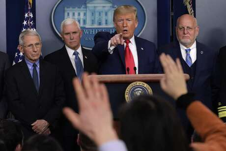 President Donald Trump takes a question from reporters during a recent press conference on COVID-19. The toxic relationship between Trump and the media is undercutting efforts to contain the coronavirus pandemic.