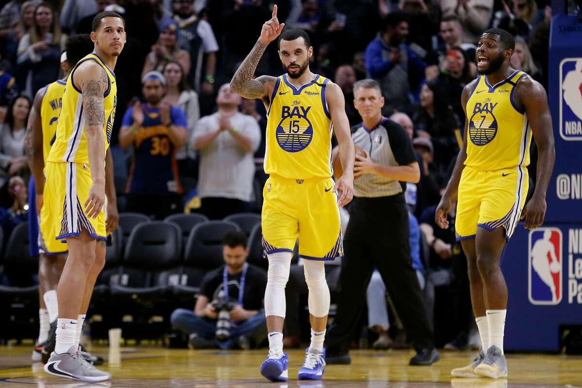 Golden State Warriors Mychal Mulder (center) reacts late in the fourth quarter of an NBA game against the Philadelphia 76ers at Chase Center on Saturday, March 7, 2020, in San Francisco, Calif. The Warriors won 118-114.
