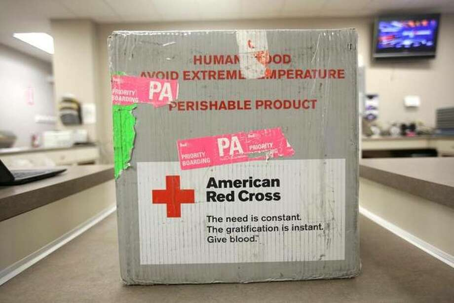 FILE - This Monday, March 9, 2020 file photo shows donated blood in a transportation case at an American Red Cross donation center. (Jake Danna Stevens/The Times-Tribune via AP)