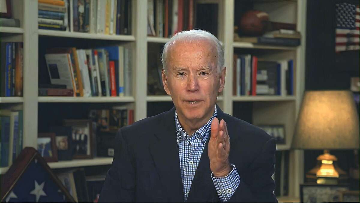 In this image from video provided by the Biden for President campaign, Democratic presidential candidate former Vice President Joe Biden speaks during a virtual press briefing Wednesday, March 25, 2020. (Biden for President via AP)