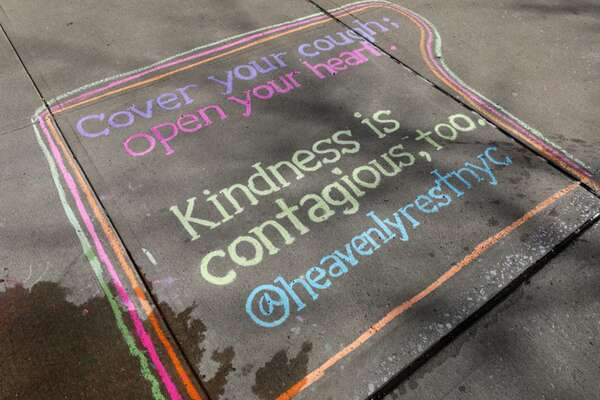 A chalk drawing in New York City encourages people to take simple steps to slow the spread of the new coronavirus. (Getty Images/TNS)