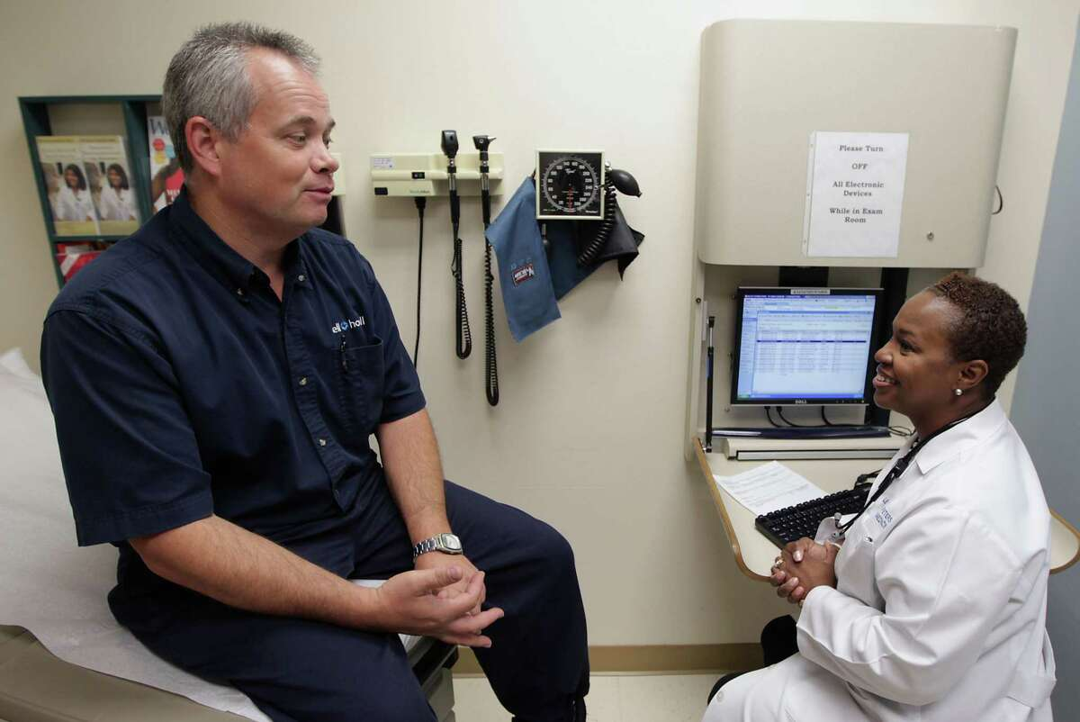 A primary care physician can help you manage current medical issues and plan health and wellness goals in the long-term. Dale Peterson, left, speaks with Dr. LeCresha Peters during a follow up doctor's appointment for his annual checkup at the Kelsey-Seybold Clinic in Pearland Tuesday, June 18, 2013, in Houston. ( James Nielsen / Houston Chronicle )