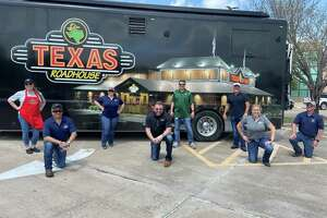 On Tuesday, March 24, a crew from Texas Roadhouse serves approximately 2,500 meals to Mayde Creek High School students and families. The restaurant company plans to serve at 30 locations during the coronavirus outbreak. Katy was the first stop.