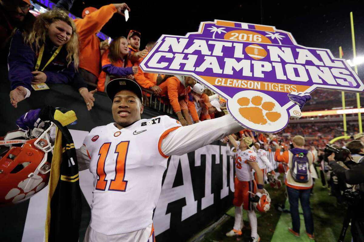 TAMPA, FL - JANUARY 09: Safety Isaiah Simmons #11 of the Clemson Tigers celebrates after defeating the Alabama Crimson Tide 35-31 to win the 2017 College Football Playoff National Championship Game at Raymond James Stadium on January 9, 2017 in Tampa, Florida. (Photo by Jamie Squire/Getty Images) ORG XMIT: 686857421