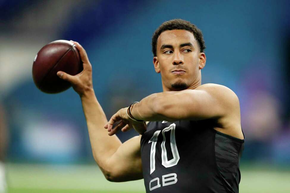 FILE - In this Thursday, Feb. 27, 2020, file photo, Utah State quarterback Jordan Love works out at the NFL football scouting combine in Indianapolis. After turning heads last month at the Senior Bowl, Love delivered with another impressive workout Thursday.