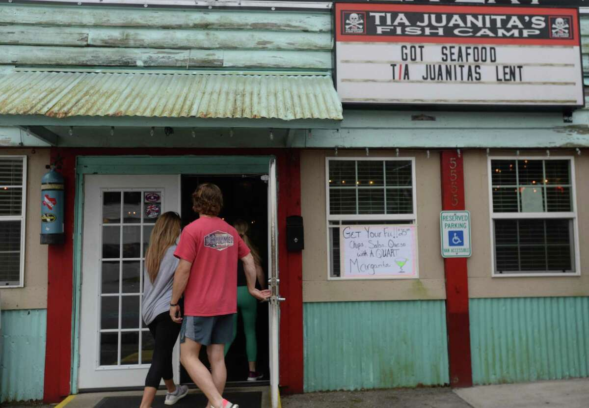 Friends make their way inside Tia Juanita's in Beaumont to pick up an order on the first day of area restaurant and bar closures. Photo taken Thursday, March 19, 2020 Kim Brent/The Enterprise