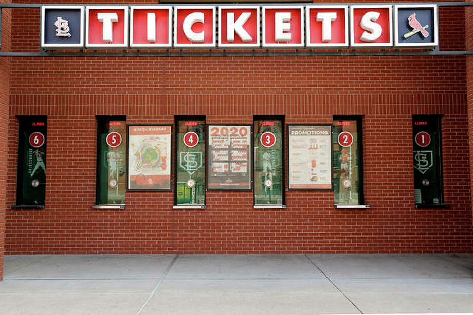Closed ticket windows are seen outside Busch Stadium Wednesday in St. Louis. The start of the regular season, which was set to start on Thursday, is on hold indefinitely because of the coronavirus pandemic. Major League Baseball has pushed back all regular season games until mid-May at the earliest. That extends an earlier decision last Thursday to postpone its regular-season openers by at least two weeks. The Cardinals had been scheduled to start their season Thursday against the Cincinnati Reds at Great American Ball Park. The Cardinals' home opener at Busch was originally scheduled for April 2 against the Baltimore Orioles. Photo: Jeff Roberson | AP Photo