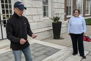 In an age of social distancing, First Selectman Fred Camillo joins a crowd of one for the town's official observation of Greek Independence Day on Wednesday. Camillo is joined by Board of Estimate and Taxation Vice Chair Karen Fassuliotis, who put the event together to as a tribute to her own heritage and other Greek Americans in town.