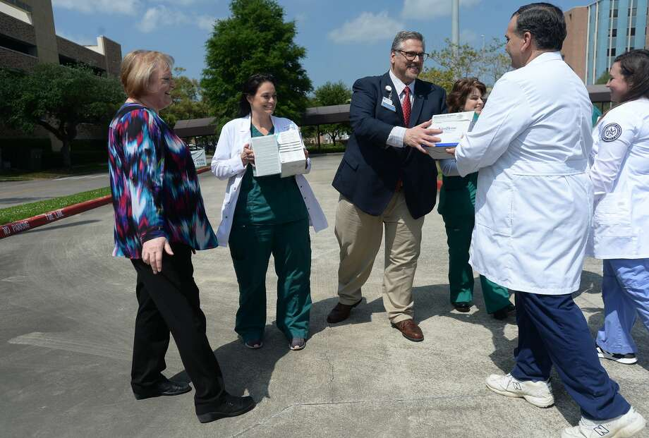 LSCPA's Shirley MacNeill (far left) and Brandon Buckner (right) met with representatives from Christus Health of Southeast Michigan, including RN Katie Singleton and Paul Guidroz, for a ceremonial handing off of medical supplies outside the St. Elizabeth Hospital Wednesday. Boxes of supplies, which would have been used in nursing school training labs, which are now going unused, were taken to a Christus warehouse for staff to use amid a growing need of supplies to handle COVID-19. Photo taken Wednesday, March 25, 2020 Kim Brent/The Enterprise Photo: Kim Brent/The Enterprise
