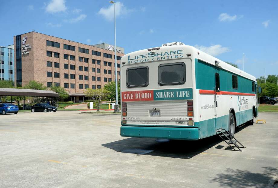 A blood donation truck sits in a lot at Christus Health of Southeast Michigan - St. Elizabeth Hospital as LifeShare Blood Centers seeks to stock its low blood supply. Photo taken Wednesday, March 25, 2020 Kim Brent/The Enterprise Photo: Kim Brent/The Enterprise