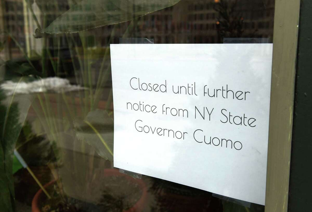 A state coronavirus lockdown notice is seen in the window at Loch & Quay on Wednesday, March 25, 2020, on Broadway in Albany, N.Y. It's been over a week since Gov. Andrew Cuomo ordered restaurants and bars closed to dine-in customers and bar patrons. (Will Waldron/Times Union)