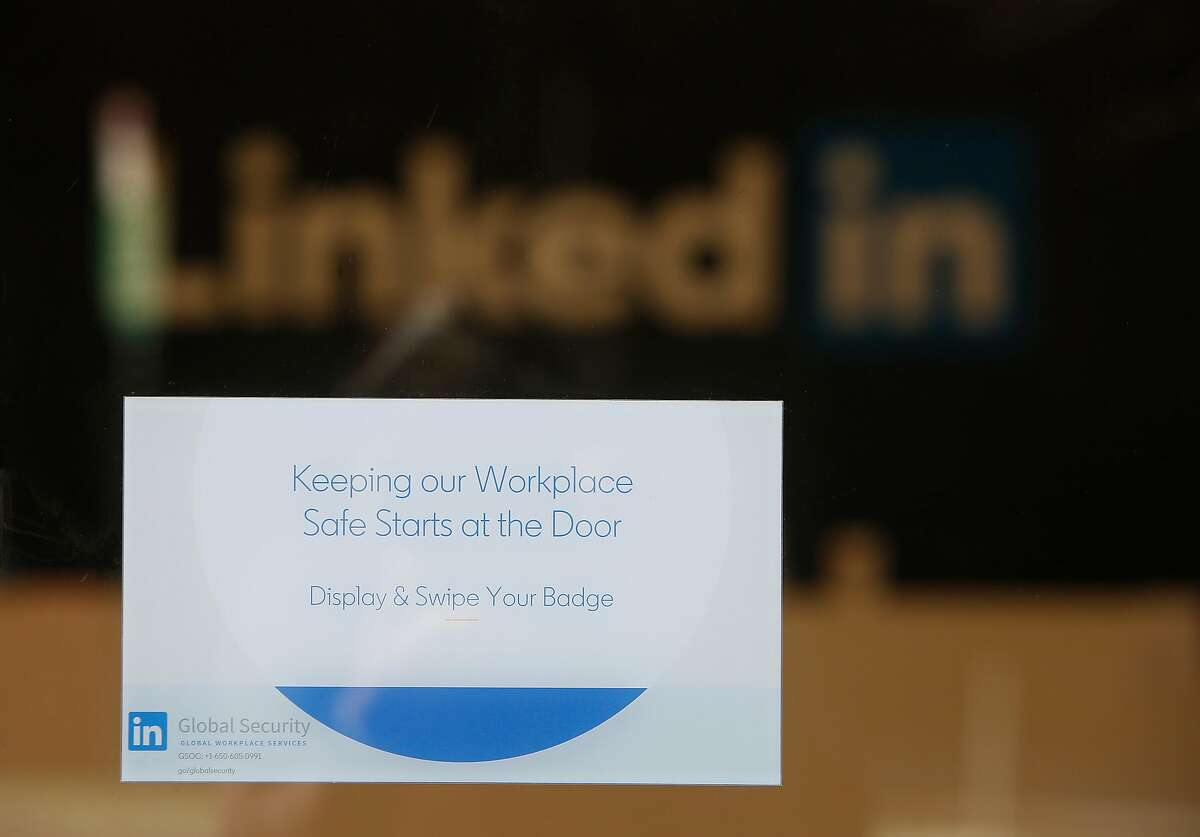 A security sign is seen on the entrance doors at the Linked In building at 222 Second Street on Wednesday, March 25, 2020 in San Francisco, Calif.