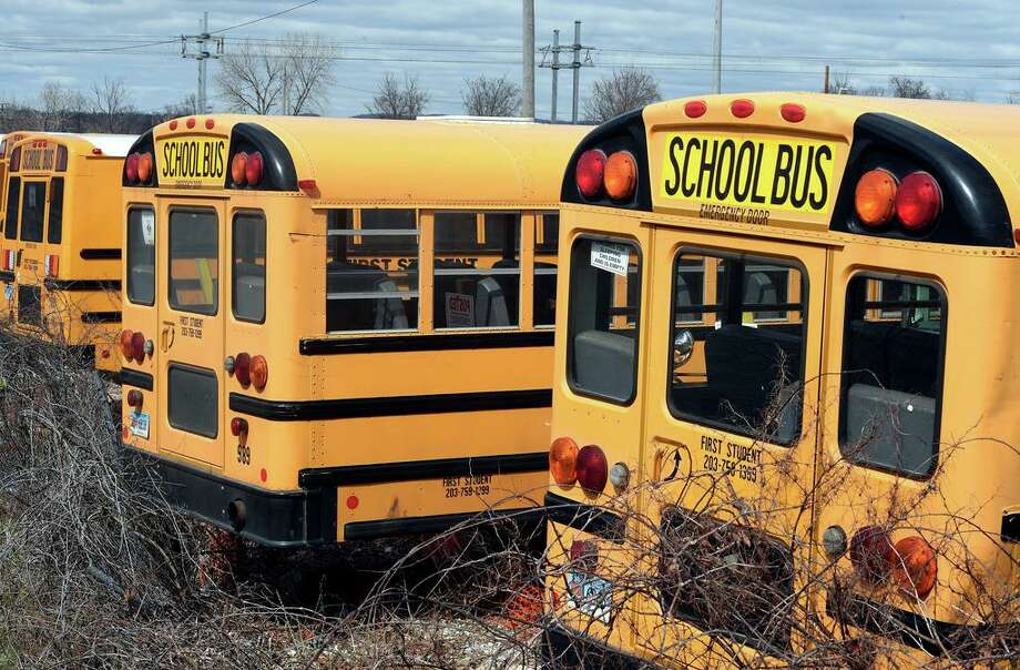 Buses remain idle in the First Student bus company lot on Middletown Avenue in New Haven on March 24, 2020. Photo: Arnold Gold / Hearst Connecticut Media / New Haven Register