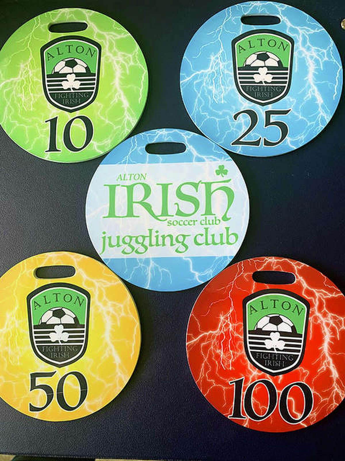 """Special bag tags are awarded to players in the Alton Fighting Irish Soccer Club's """"Juggling Club"""" for each they reach for juggling a soccer ball with their feet without it hitting the ground."""
