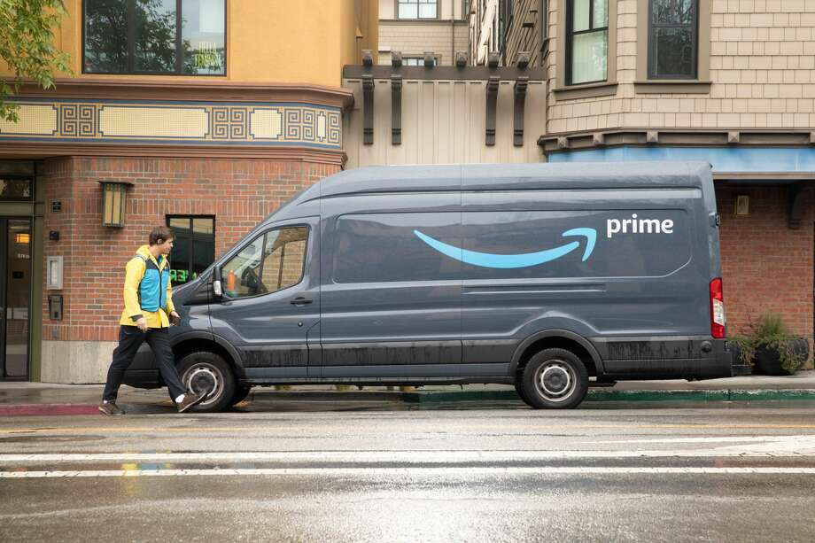 An Amazon Prime delivery truck delivers packages during the coronavirus shelter-in-place order in Berkeley, Calif. on March 25, 2020. Photo: Douglas Zimmerman/SFGate / SFGate