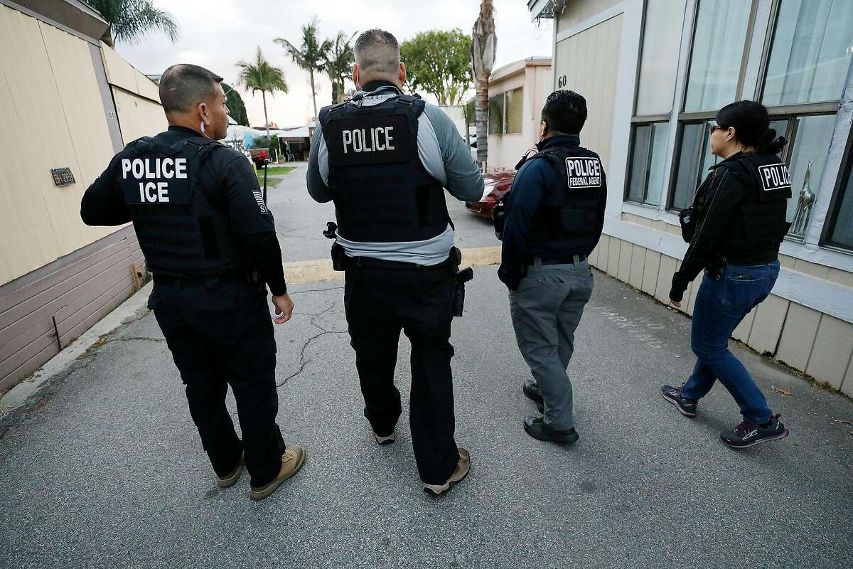 David A. Marin, left, Field Office Director Enforcement and Removal Operations Los Angeles Field Office of U.S. Immigration and Customs Enforcement (ICE) as agents advance on a residence during early morning apprehensions as ICE officers are joined by (CBP) U.S. Customs & Border Protection agents in the last few weeks, as more resources are deployed in sanctuary cities. (Al Seib/Los Angeles Times/TNS)