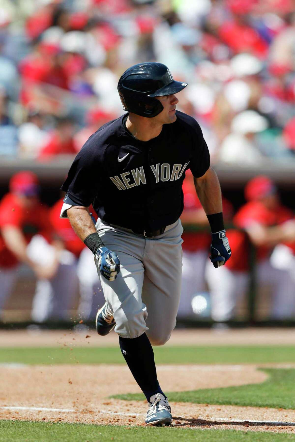 New York Yankees' Thomas Milone runs to first during a spring training baseball game, Monday, March 9, 2020, in Clearwater, Fla. (AP Photo/Carlos Osorio)