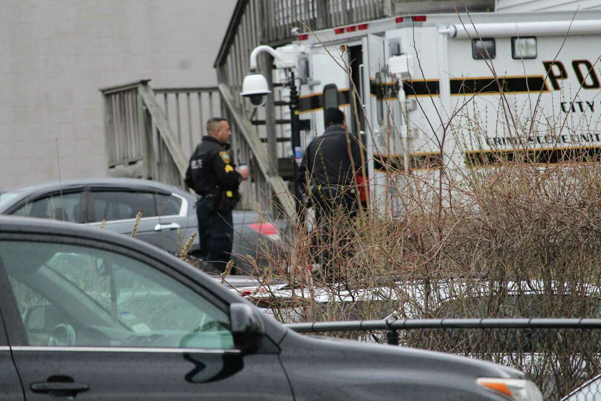 Norwalk police investigate a murder-suicide involving a man and his two children Monday on Elizabeth Street in South Norwalk.